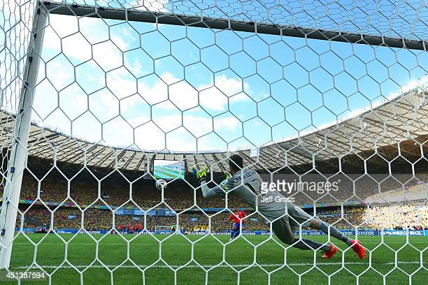 Gonzalo Jara of Chile shoots and hits the post to miss the decisive penalty against Julio Cesar of Brazil during the 2014 FIFA World Cup Brazil round...