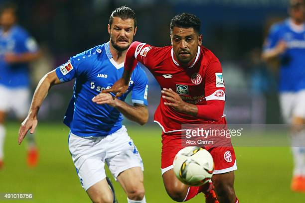 Gonzalo Jara of Mainz is challenged by Marcel Heller daa during the Bundesliga match between SV Darmstadt 98 and 1FSV Mainz 05 at MerckStadion am...