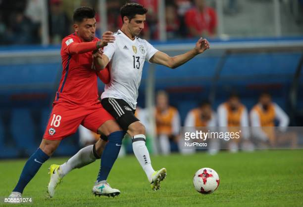 Gonzalo Jara of the Chile national football team and Lars Stindl of the Germanyl national football team vie for the ball during the 2017 FIFA...