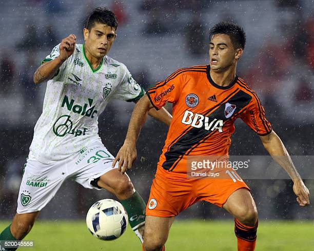 Gonzalo Martinez of River Plate and Alexis Niz of Sarmiento vie for the ball during a match between River Plate and Sarmiento as part of Torneo...