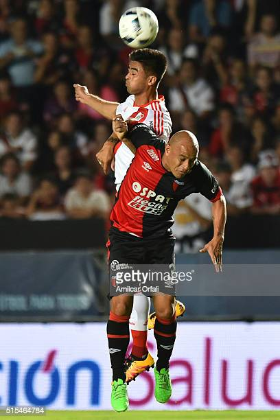 Gonzalo Martinez of River Plate and Clemente Rodriguez of Colon jump for a header during a match between Colon and River Plate as part of Torneo de...