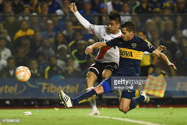 Gonzalo Martinez of River Plate and Fernando Gago of Boca Juniors fight for the ball during a second leg match between Boca Juniors and River Plate...