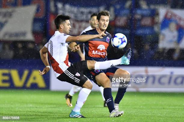 Gonzalo Martinez of River Plate and Lucas Menossi of Tigre fight for the ball during a match between Tigre and River Plate as part of Superliga...