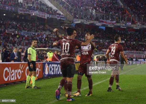 Gonzalo Martinez of River Plate celebrates with teammates after scoring the first goal of his team during a match between River Plate and Banfield as...