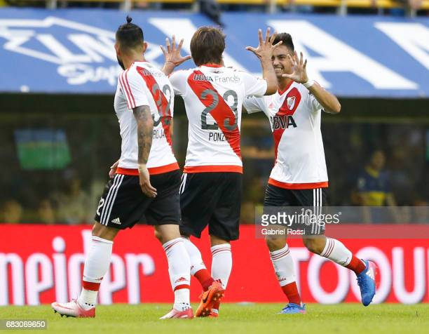Gonzalo Martinez of River Plate celebrates with teammates Leonardo Ponzio and Ariel Rojas after scoring the first goal of his team during a match...