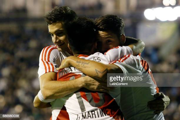 Gonzalo Martinez of River Plate celebrates with teammates Lucas Alario and Sebastian Driussi after scoring the second goal of his team during a match...