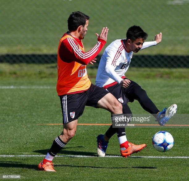 Gonzalo Martinez of River Plate fights for the ball with Camilo Mayada of River Plate during a training session at River Plate's training camp on...