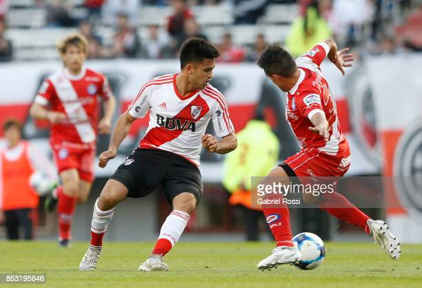 Gonzalo Martinez of River Plate fights for the ball with Fausto Montero of Argentinos Juniors during a match between River Plate and Argentinos...