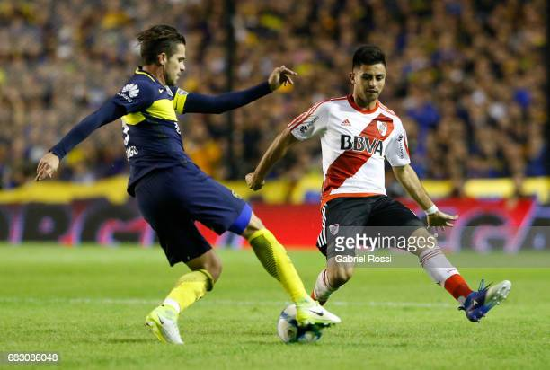 Gonzalo Martinez of River Plate fights for the ball with Fernando Gago of Boca Juniors during a match between Boca Juniors and River Plate as part of...