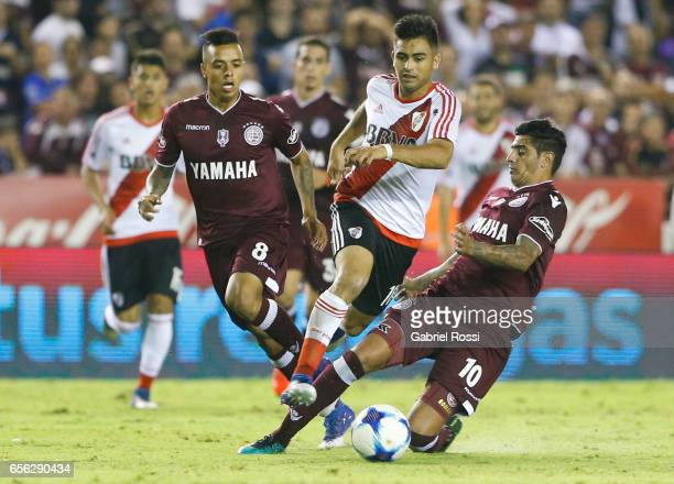 Gonzalo Martinez of River Plate fights for the ball with Roman Martinez of Lanus during a match between Lanus and River Plate as part of Torneo...