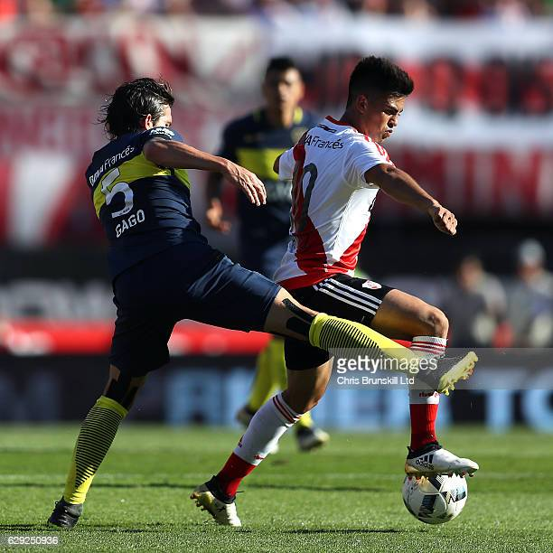 Gonzalo Martinez of River Plate in a action with Fernando Gago of Boca Juniors during the Argentine Primera Division match between River Plate and...