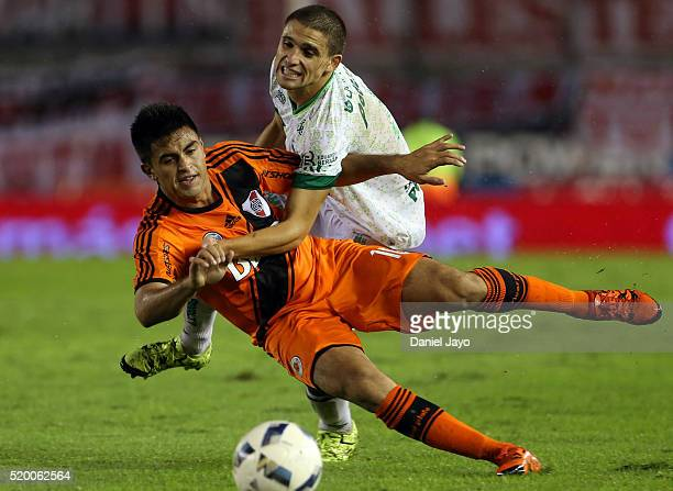 Gonzalo Martinez of River Plate is fouled by Fermin Antonini of Sarmiento during a match between River Plate and Sarmiento as part of Torneo...