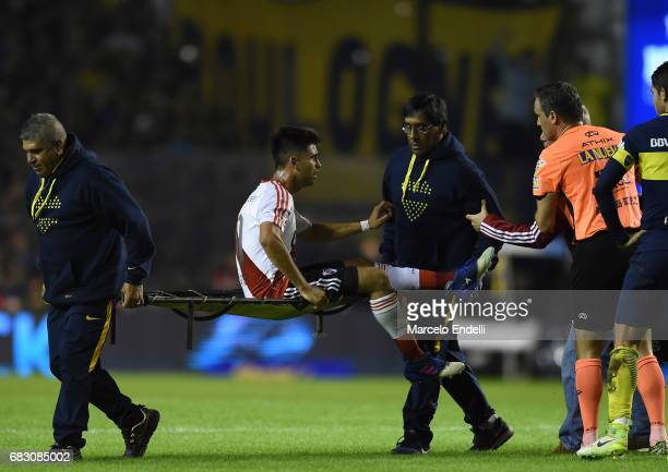 Gonzalo Martinez of River Plate is taking out the field on a stretcher during a match between Boca Juniors and River Plate as part of Torneo Primera...
