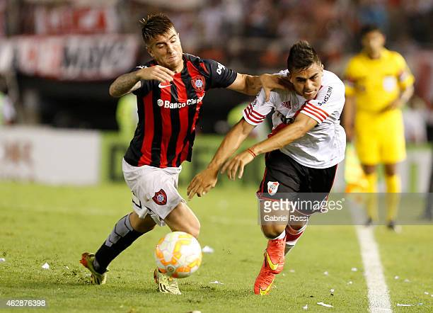 Gonzalo Martinez of River Plate Plate fights for the ball with Julio Buffarini of San Lorenzo during a first leg match between River Plate Plate and...