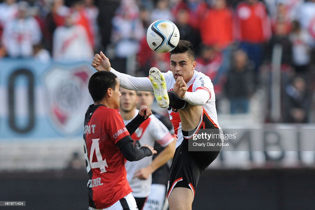 Gonzalo Martinez of River Plate struggles for the ball with Osvaldo Arroyo of Colon de Santa Fe during a match between River Plate and Colon de Santa...