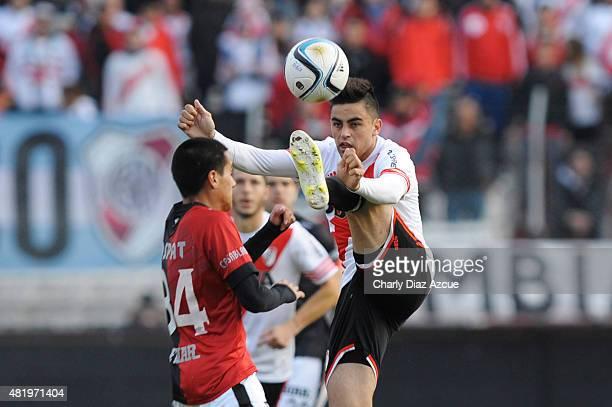 Gonzalo Martinez of River Plate struggles for the ball with Osvaldo Arroyo of Colon de Santa Fe during a match between River Plate and Colon de Santa...