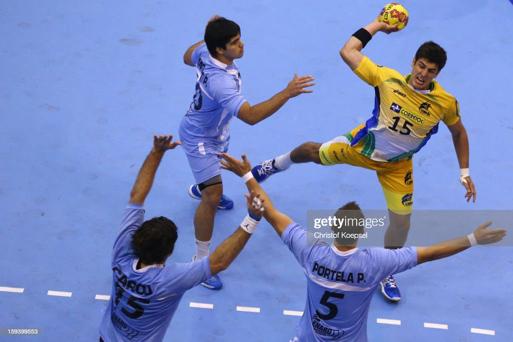 Gonzalo Matias Carou Marcel, Pablo Smonet and Pablo Portela of Argentina defend against Arthur Patrianova of Brazil (R) during the premilary group A match between Brasil and Argentina and Montenegro at Palacio de Deportes de Granollers on January 13, 2013 in Granollers, Spain.
