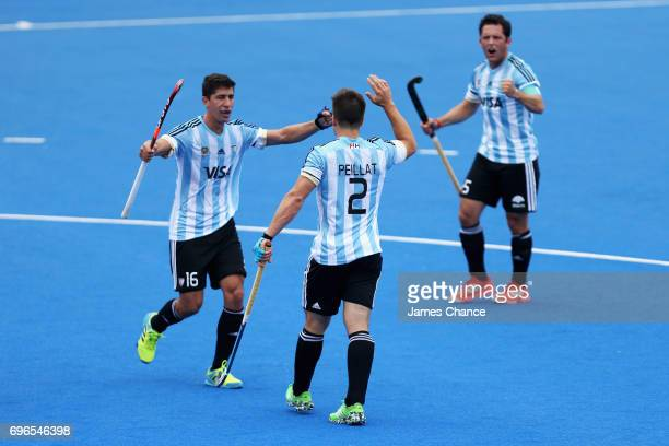 Gonzalo Peillat of Argentina celebrates scoring with his team mate Ignacio Ortiz of Argentina during the Pool A match between Korea and Argentina on...