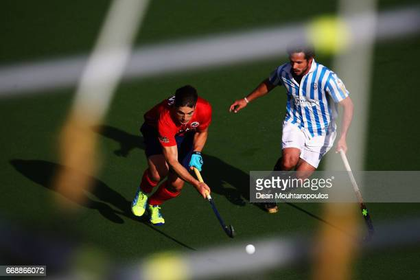 Gonzalo Peillat of Mannheimer HC battles for the ball with Pau Quemada of Club Egara during the Euro Hockey League KO16 match between Mannheimer HC...