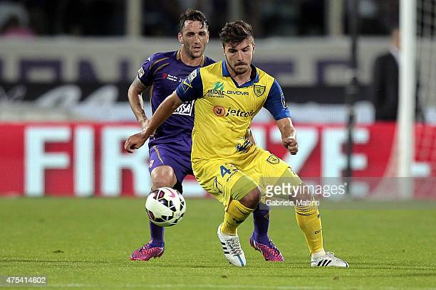 Gonzalo Rodriguez of ACF Fiorentina battles for the ball with Alberto Paloschi of AC Chievo Verona during the Serie A match between ACF Fiorentina...