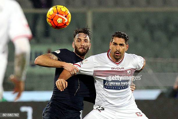 Gonzalo Rodriguez of ACF Fiorentina battles for the ball with Marco Borriello of Carpi Fc during the TIM Cup match between ACF Fiorentina and Carpi...
