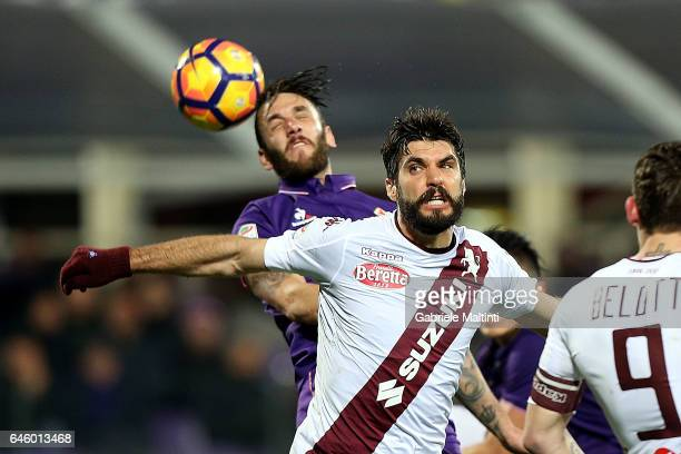 Gonzalo Rodriguez of ACF Fiorentina battles for the ball with Marco Benassi of FC Torino during the Serie A match between ACF Fiorentina and FC...