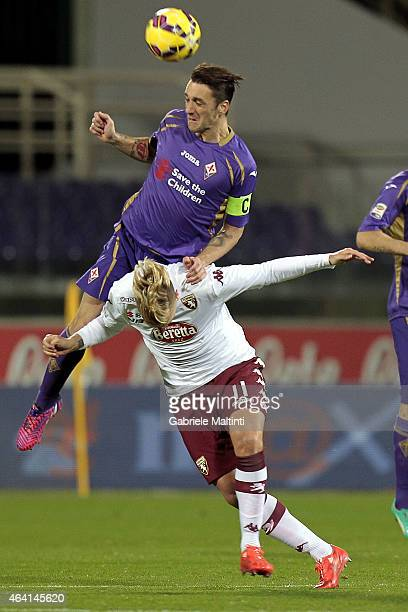 Gonzalo Rodriguez of ACF Fiorentina battles for the ball with Maxi Lopez of Torino FC during the Serie A match between ACF Fiorentina and Torino FC...