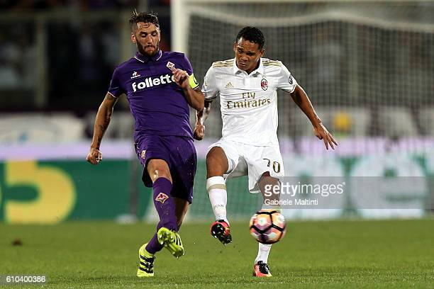 Gonzalo Rodriguez of ACF Fiorentina fights for the ball with Carlos Bacca of AC Milan during the Serie A match between ACF Fiorentina and AC Milan at...