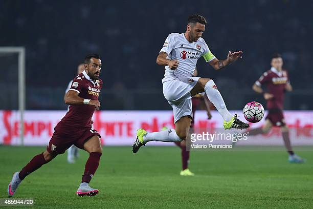 Gonzalo Rodriguez of ACF Fiorentina in action against Fabio Quagliarella of Torino during the Serie A match between Torino FC and ACF Fiorentina at...