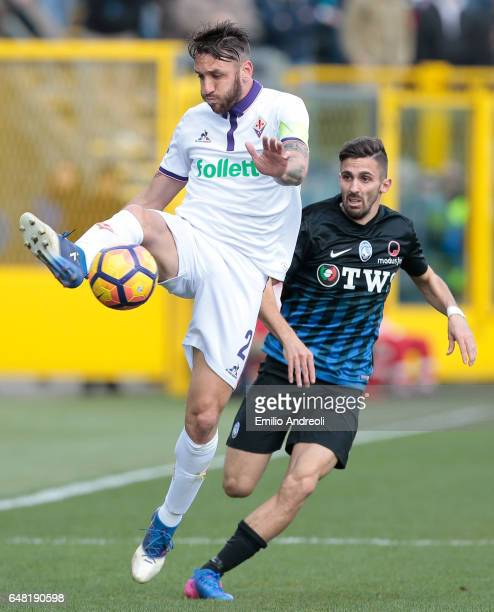 Gonzalo Rodriguez of ACF Fiorentina jumps for the ball against Marco D Alessandro of Atalanta BC during the Serie A match between Atalanta BC and ACF...