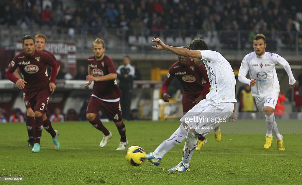 Gonzalo Rodriguez of ACF Fiorentina scores from the penalty spot during the Serie A match between Torino FC and ACF Fiorentina at Stadio Olimpico di Torino on November 25, 2012 in Turin, Italy.