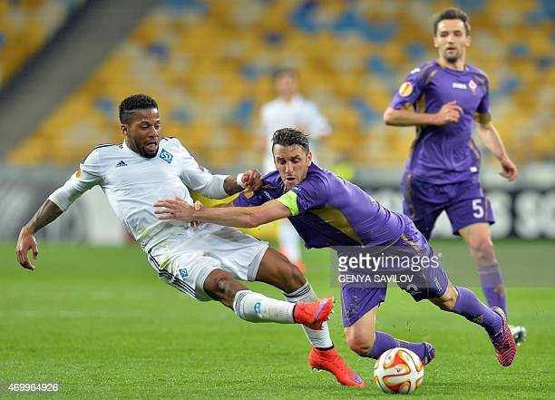 Gonzalo Rodriguez of ACF Fiorentina vies for the ball against Jeremain Lens of FC Dynamo Kyiv during their UEFA Europa League quarterfinal first leg...