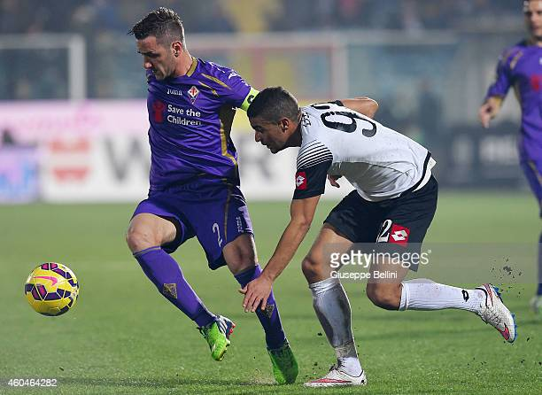 Gonzalo Rodriguez of Fiorentina and Gregoire Defrel of Cesena in action during the Serie A match between AC Cesena and ACF Fiorentina at Dino Manuzzi...