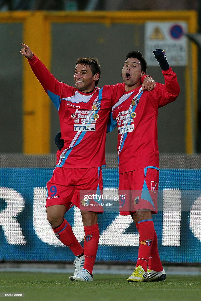 Gonzalo Ruben Bergessio (L) and Lucas Nahuel Castro of Calcio Catania celebrates after scoring a goal during the Serie A match between AC Siena and Calcio Catania at Stadio Artemio Franchi on December 9, 2012 in Siena, Italy.