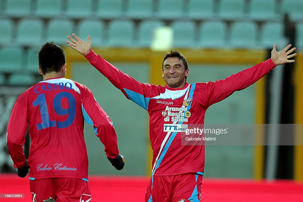 Gonzalo Ruben Bergessio (R) and Lucas Nahuel Castro of Calcio Catania celebrates after scoring a goal during the Serie A match between AC Siena and Calcio Catania at Stadio Artemio Franchi on December 9, 2012 in Siena, Italy.