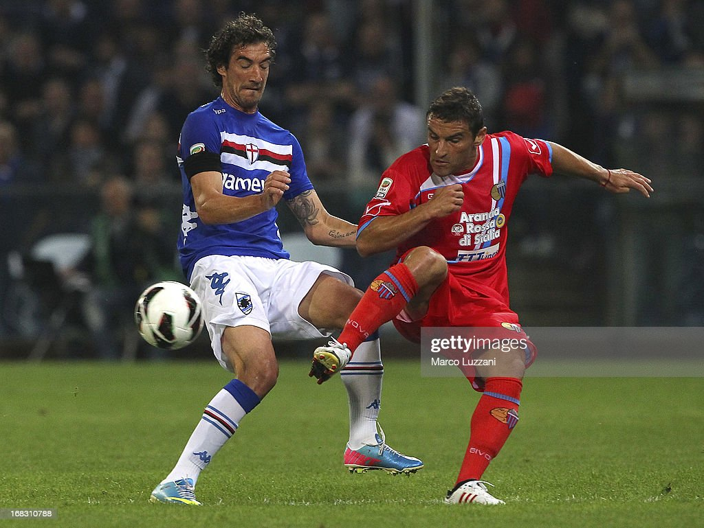 Gonzalo Ruben Bergessio (R) of Calcio Catania competes for the ball with Paolo Castellini (L) of UC Sampdoria during the Serie A match between UC Sampdoria and Calcio Catania at Stadio Luigi Ferraris on May 8, 2013 in Genoa, Italy.
