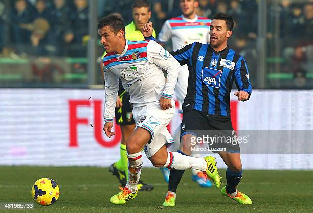 Gonzalo Ruben Bergessio of Calcio Catania competes for the ball with Luca Cigarini of Atalanta BC during the Serie A match between Atalanta BC and...