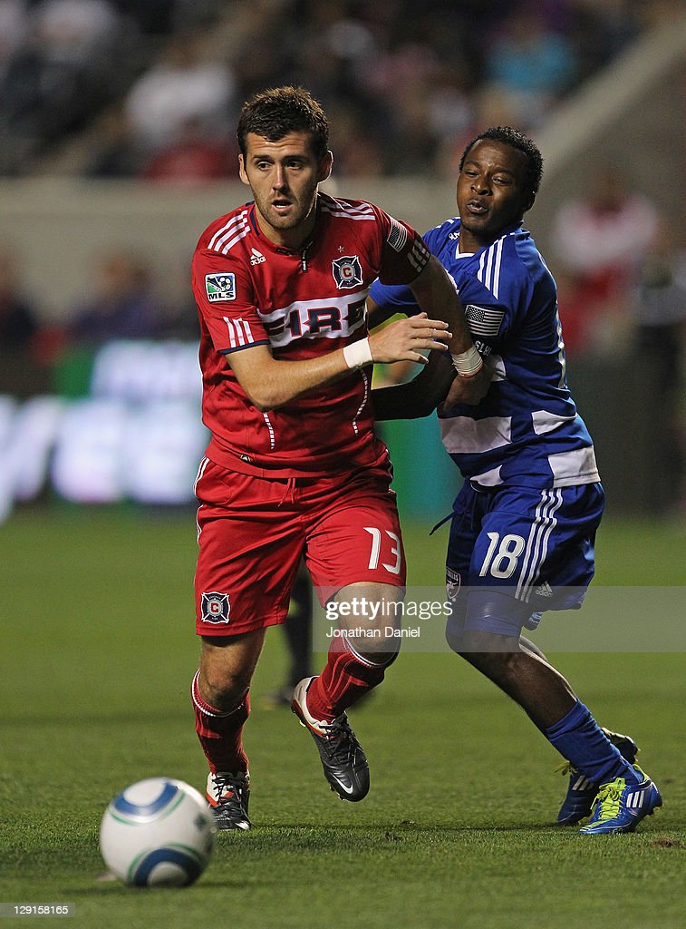 Gonzalo Segares #13 of the Chicago Fire battles with Marvin Chavez #18 of FC Dallas as they chase down the ball during an MLS match at Toyota Park on October 12, 2011 in Bridgeview, Illinois. FC Dallas defeated the Fire 2-1.