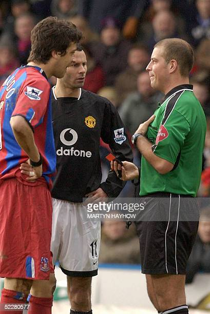 Gonzalo Sorondo of Crystal Palace and Ryan Giggs of Manchester United both about to be booked by referee M Clattenburg 05 March 2005 at the South...