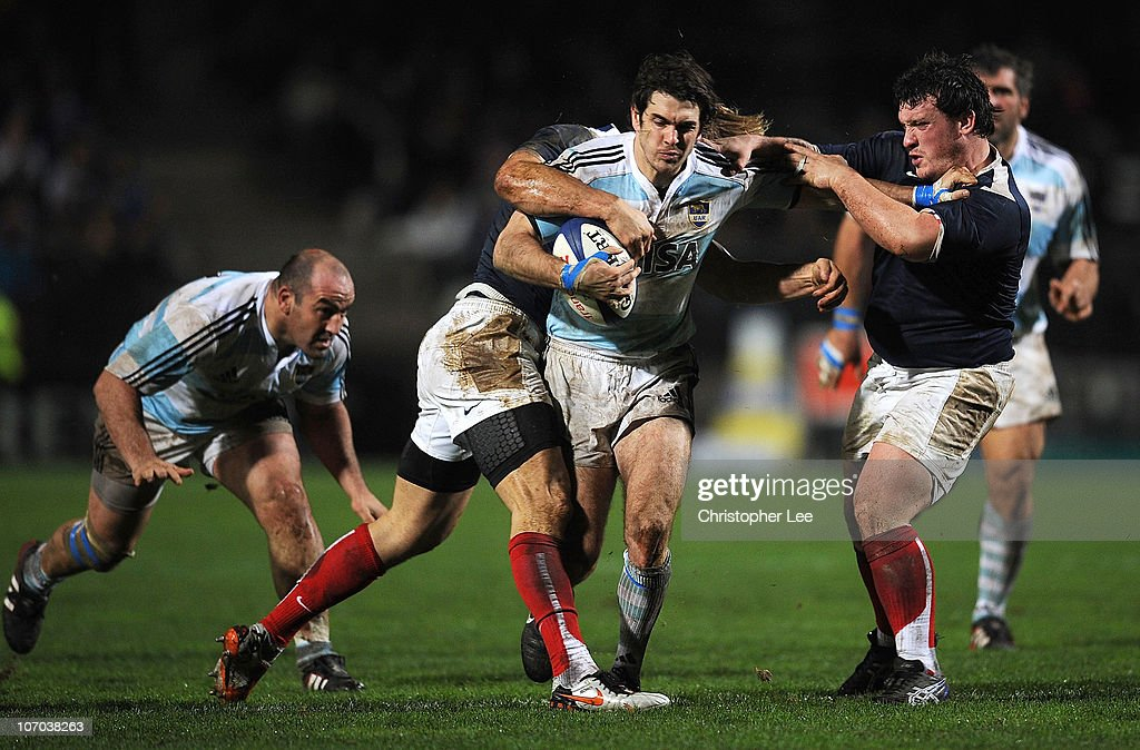 Gonzalo Tiesi of Argentina takes on <a gi-track='captionPersonalityLinkClicked' href=/galleries/search?phrase=Aurelien+Rougerie&family=editorial&specificpeople=220239 ng-click='$event.stopPropagation()'>Aurelien Rougerie</a> and <a gi-track='captionPersonalityLinkClicked' href=/galleries/search?phrase=Thomas+Domingo&family=editorial&specificpeople=4651174 ng-click='$event.stopPropagation()'>Thomas Domingo</a> of France during the International Friendly match between France and Argentina at the Stade de la Mosson on November 20, 2010 in Montpellier, France.