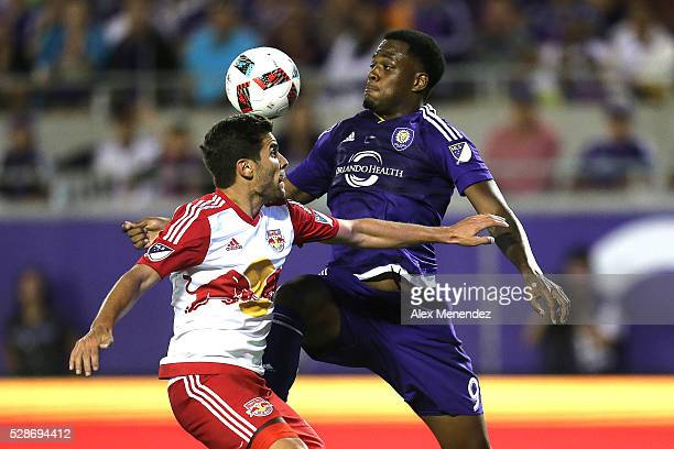 Gonzalo Veron of New York Red Bulls and Cyle Larin of Orlando City SC fight for the ball during an MLS soccer match at Camping World Stadium on May 6...