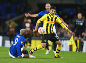 Gonzalo Zarate of BSC Young Boys and Arouna Kone of Everton compete for the ball during the UEFA Europa League Round of 32 match between Everton FC...
