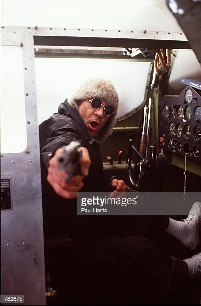 Gonzo journalist Hunter S Thompson points a pistol from a link trainer September 1990 in Woody Creek near Aspen CO