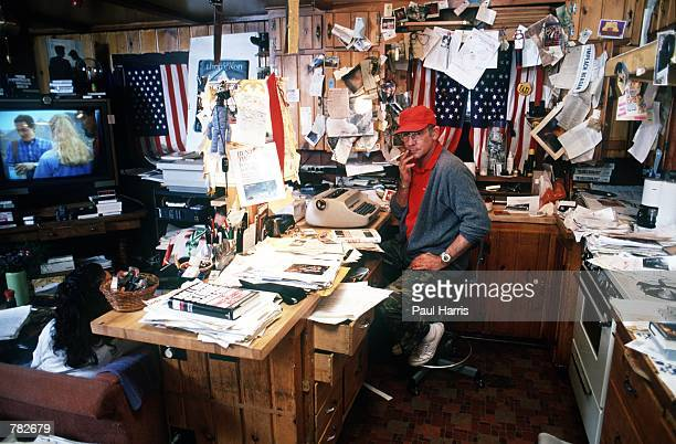 Gonzo journalist Hunter S Thompson sits in his home September 1990 at Woody Creek near Aspen CO