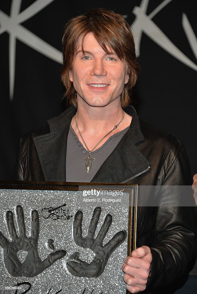 Goo Goo Dolls band member <a gi-track='captionPersonalityLinkClicked' href=/galleries/search?phrase=John+Rzeznik&family=editorial&specificpeople=220876 ng-click='$event.stopPropagation()'>John Rzeznik</a> attends a ceremony inducting The Goo Goo Dolls into the Guitar Center RockWalk at Guitar Center on May 7, 2013 in Hollywood, California.