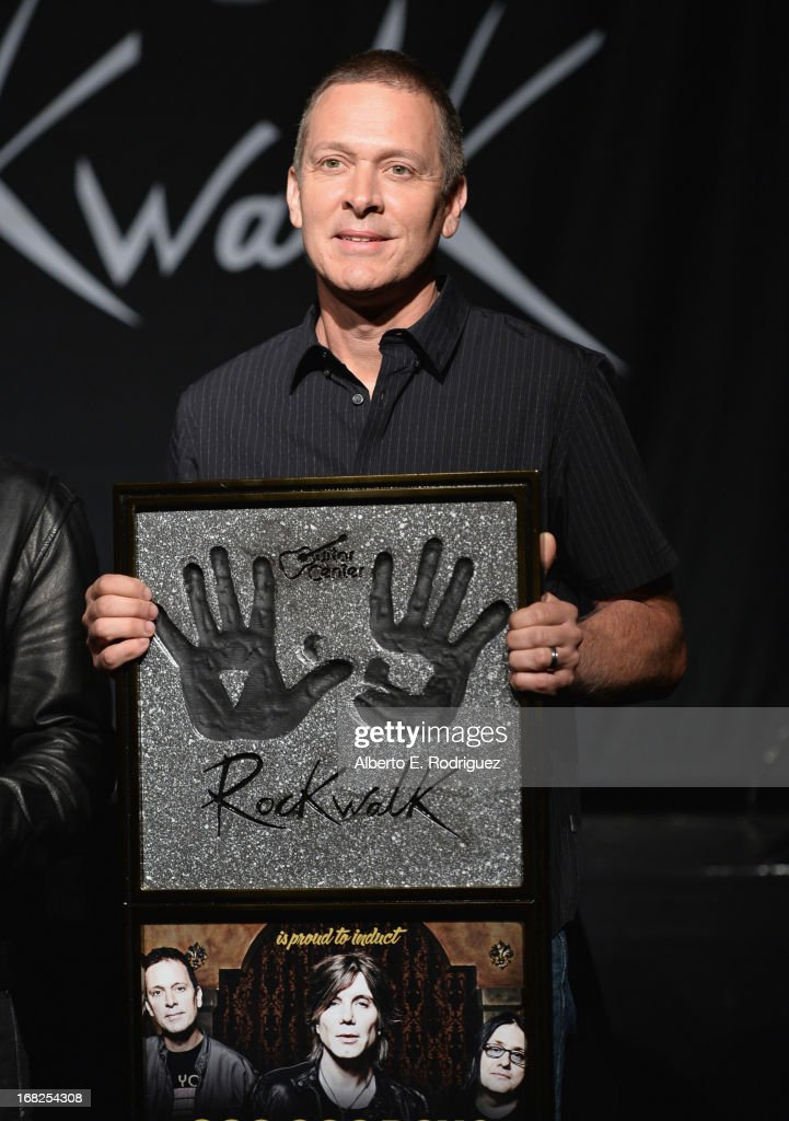 Goo Goo Dolls band member Mike Malinin attends a ceremony inducting The Goo Goo Dolls into the Guitar Center RockWalk at Guitar Center on May 7, 2013 in Hollywood, California.