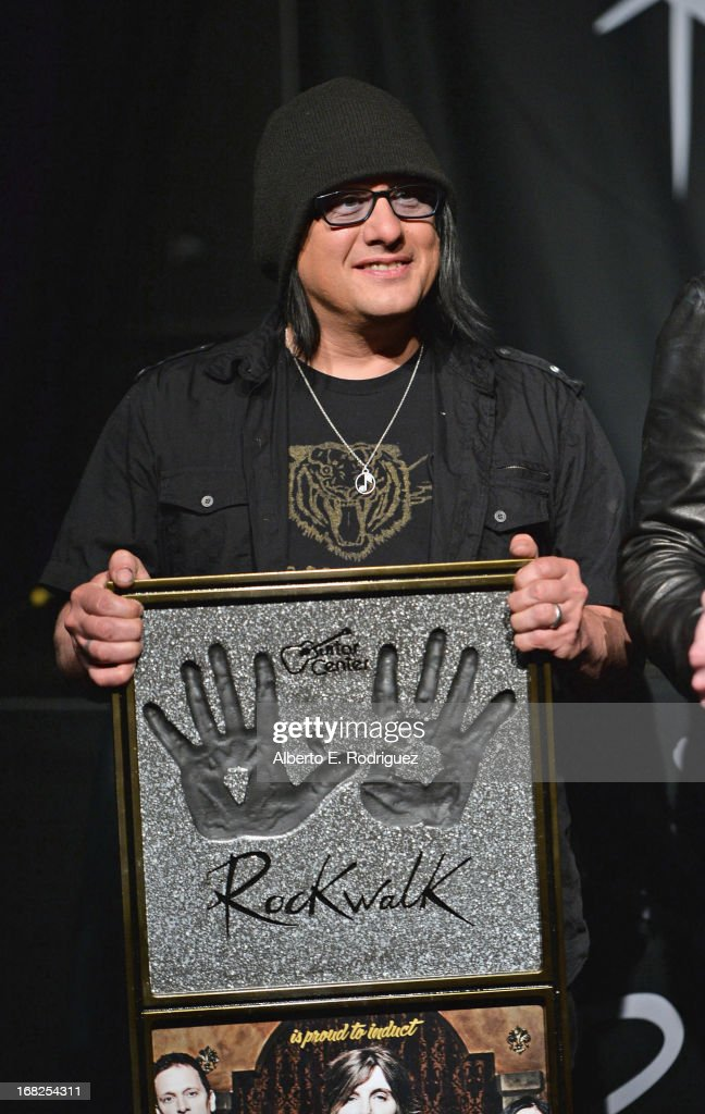 Goo Goo Dolls band member Robby Takac attends a ceremony inducting The Goo Goo Dolls into the Guitar Center RockWalk at Guitar Center on May 7, 2013 in Hollywood, California.