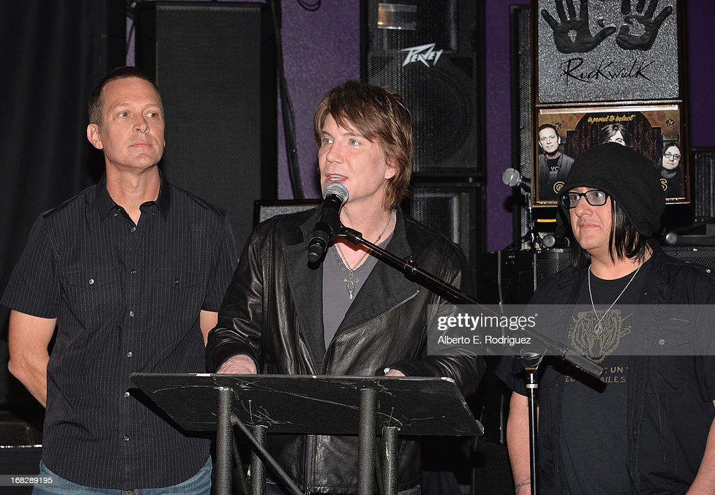 Goo Goo Dolls band members <a gi-track='captionPersonalityLinkClicked' href=/galleries/search?phrase=Mike+Malinin&family=editorial&specificpeople=883519 ng-click='$event.stopPropagation()'>Mike Malinin</a>, <a gi-track='captionPersonalityLinkClicked' href=/galleries/search?phrase=John+Rzeznik&family=editorial&specificpeople=220876 ng-click='$event.stopPropagation()'>John Rzeznik</a> and <a gi-track='captionPersonalityLinkClicked' href=/galleries/search?phrase=Robby+Takac&family=editorial&specificpeople=778886 ng-click='$event.stopPropagation()'>Robby Takac</a> attend a ceremony inducting The Goo Goo Dolls into the Guitar Center RockWalk at Guitar Center on May 7, 2013 in Hollywood, California.