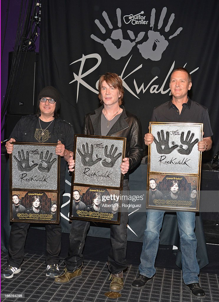 Goo Goo Dolls band members Robby Takac John Rzeznik and Mike Malinin attend a ceremony inducting The Goo Goo Dolls into the Guitar Center RockWalk at...