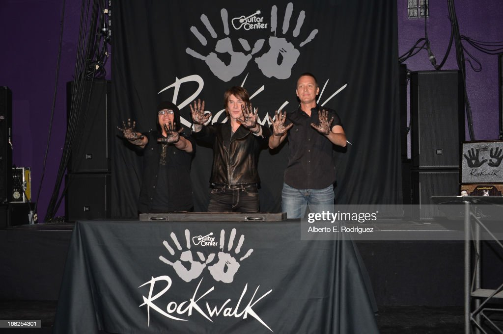 Goo Goo Dolls band members Robby Takac, John Rzeznik and Mike Malinin attend a ceremony inducting The Goo Goo Dolls into the Guitar Center RockWalk at Guitar Center on May 7, 2013 in Hollywood, California.